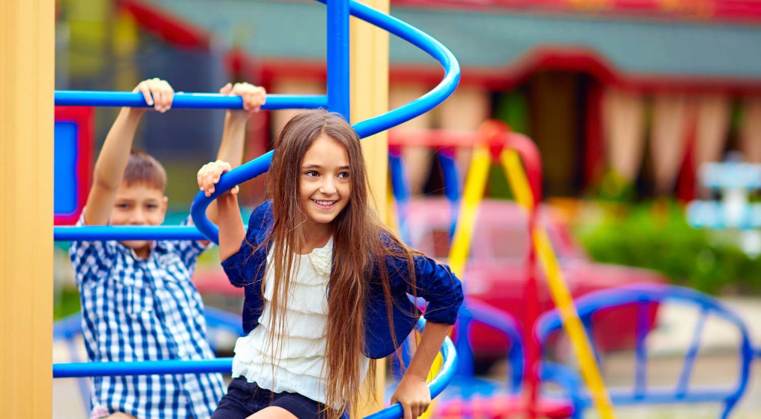 photo of two kids playing at a payground
